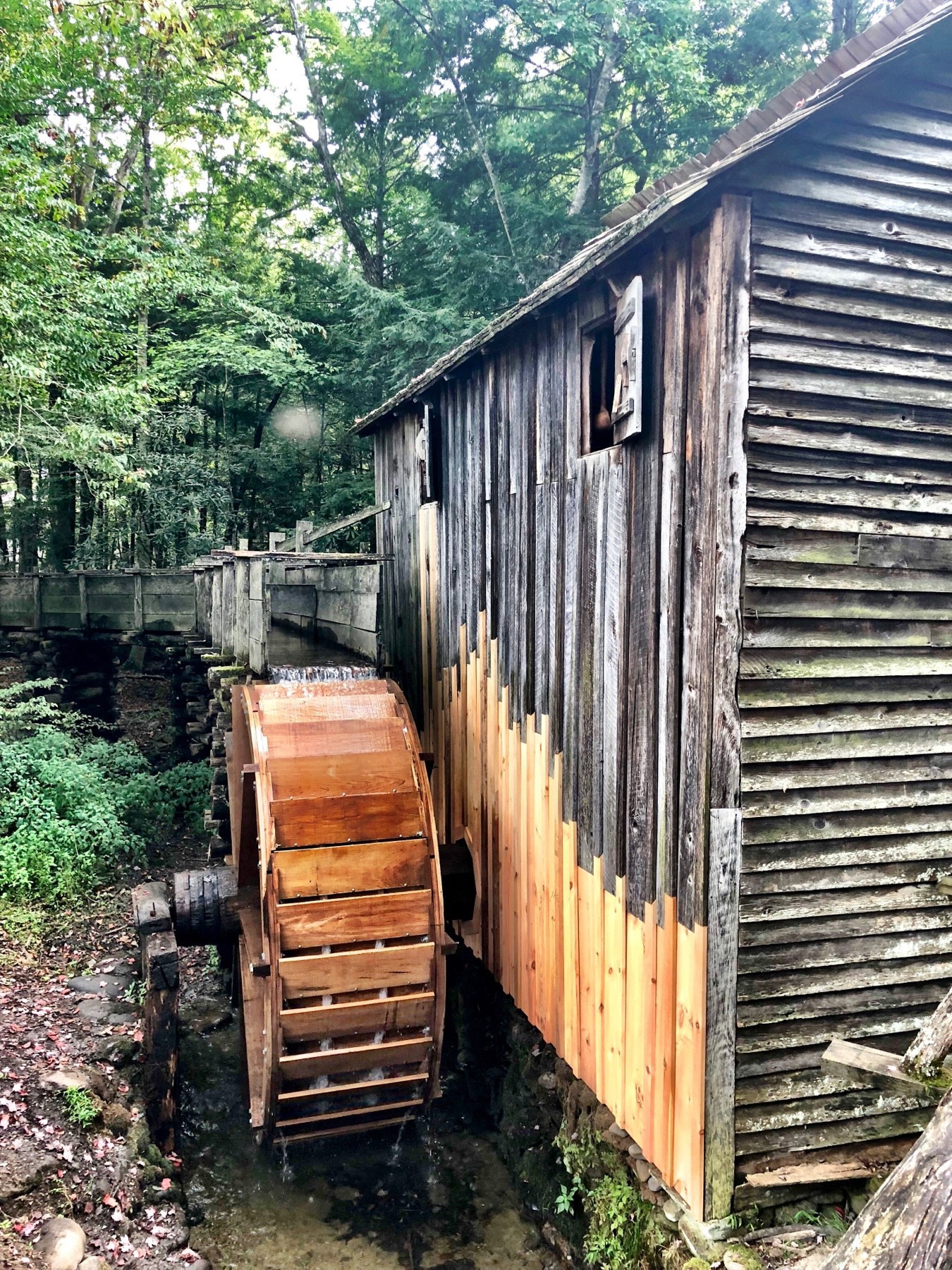 A wooden water wheel attached to a mill in Tennessee.